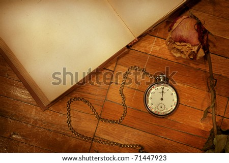 Set of the old trifles scattered on a wooden background - stock photo