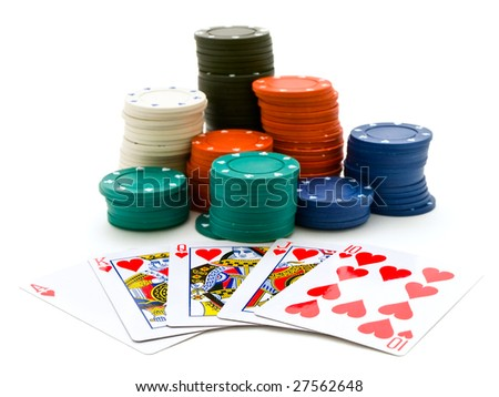 Set of the playing chips and cards at the white into the casino - stock photo