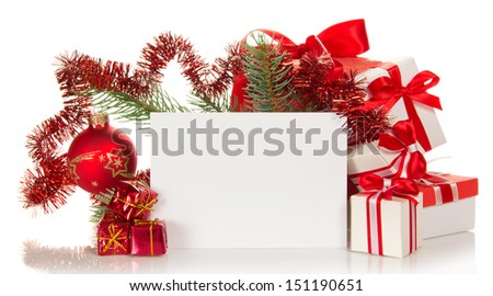 Set of the various gift boxes, the decorated branch of a fir-tree and empty card isolated on white - stock photo
