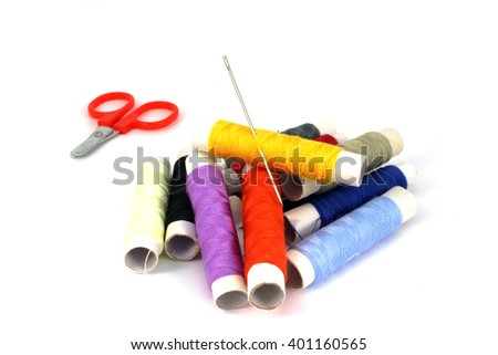 Set of thread, needle and scissors on a white background - stock photo