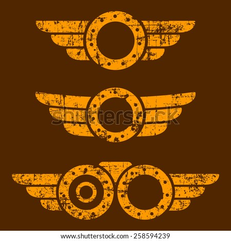 Set of three abstract grunge steam punk emblems on brown background - stock photo