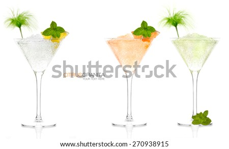 Set of three citrus fruit granitas in elegant conical cocktail glasses with decorative garnish and mint. Tropical vacation or celebration concept. Template design isolated on white with sample text. - stock photo