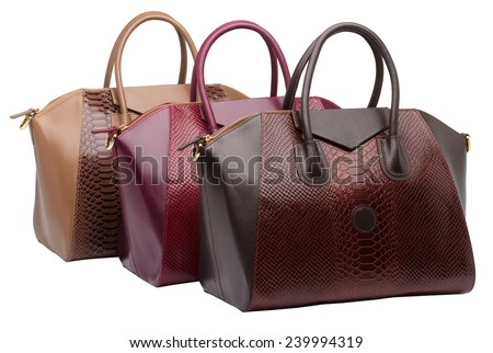 Set of three natural leather female purses different colour (red, brown and khaki) isolated on white background