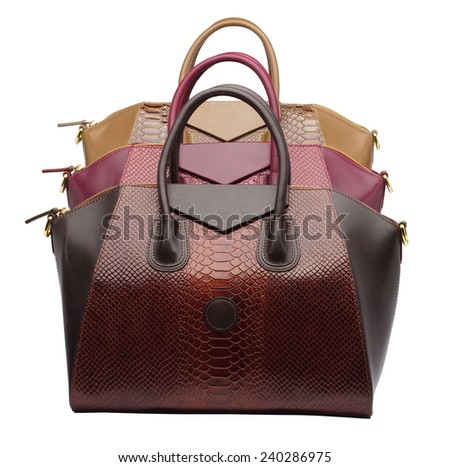 Set of three natural leather female purses different colour (red, brown and khaki) isolated on white background - stock photo