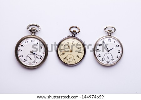 set of three old pocket watches, isolated on white - stock photo