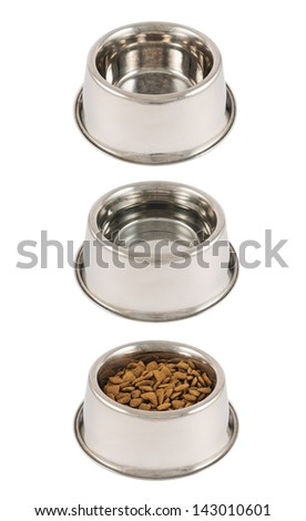 Set of three pet's dog metal bowls filled with dry food, water and empty isolated over white background - stock photo
