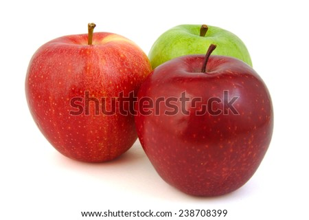 Set of three red and green apples on a bright background