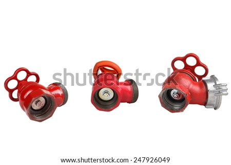 Set of three red, cast-iron fire valve to regulate the water pressure in the fire hose, an external thread for the connection of a fire hose, fire hydrants for location indoors, isolated on white. - stock photo
