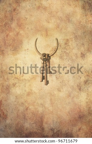 Set of three rusty keys in an open ring hanging freely, in grunge style. - stock photo