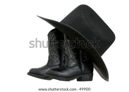Set of toddler boots and a black fetl hat isolated on white.