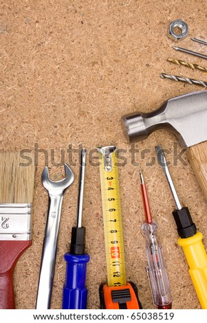 set of tools and instruments on wood texture - stock photo