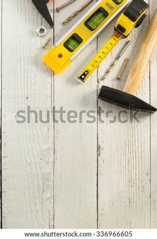 set of tools and instruments on wooden background - stock photo