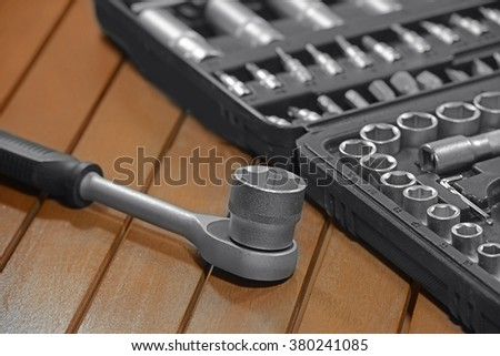 set of tools for repair in a case on a wooden table, repair, small depth of field