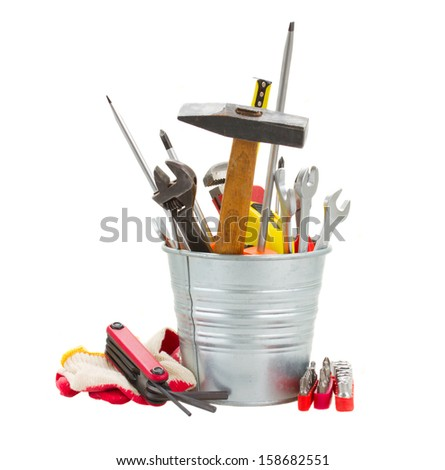 Set of tools in metal pot isolated on white background - stock photo