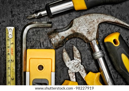 Set of tools on a textured metallic background - stock photo