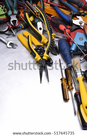 Electrical Installation Tools And Accessories Set Of On Grey Metal Surface
