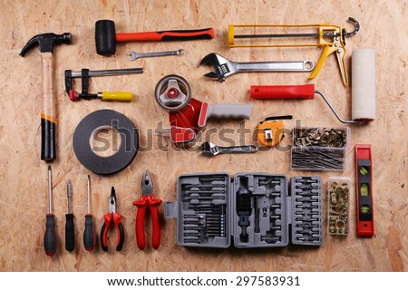 Set of tools on plywood, top view - stock photo