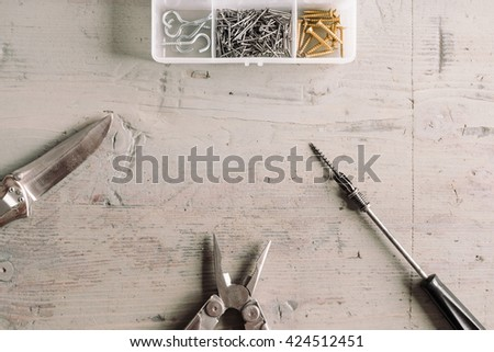 Set of tools on the grey wooden table - stock photo