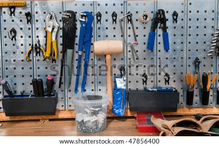 Set of tools on the wall cupboard - stock photo