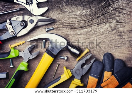 Set of tools on wooden background . - stock photo