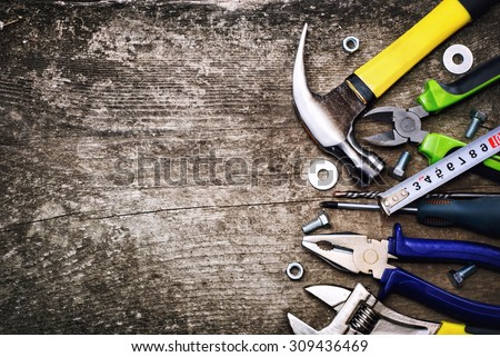 Set of tools over a wood background . - stock photo