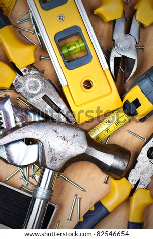 Set of tools over a wood panel - stock photo