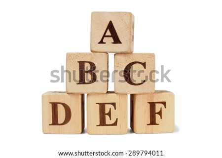 Set of toy wooden blocks alphabet on them - stock photo