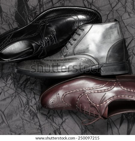 Set of trendy man footwear on a black background - stock photo