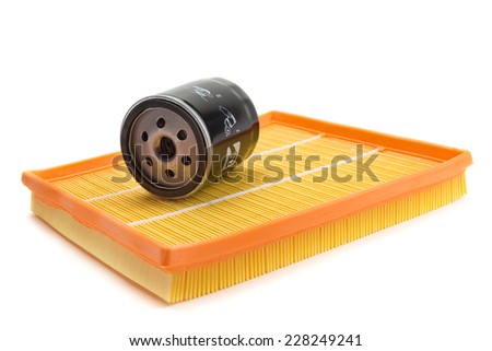 Set of two air filters and oil filter isolated on white. - stock photo