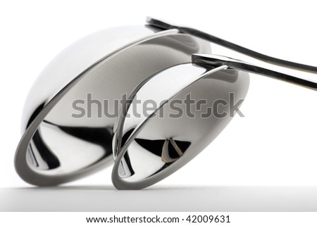 Set of two chrome-plated ladle on a white background. Fragment