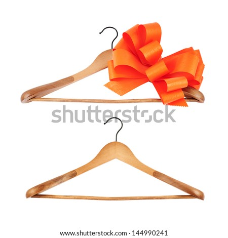 Set of two classic wooden coat hanger with a big red ribbon bow and without, isolated over white background - stock photo