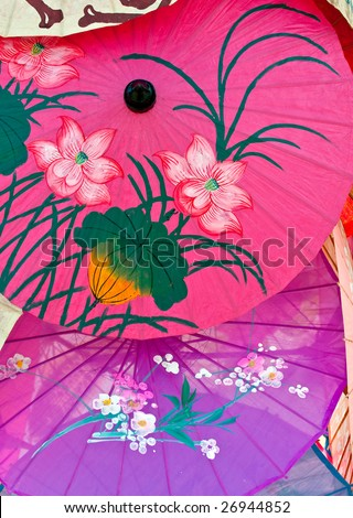 Set of typical and colorful umbrellas with decorative pattern. - stock photo