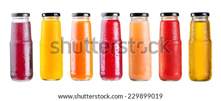 set of various bottles of juice isolated on white background - stock photo