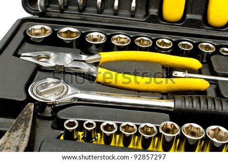 Set of various chrome yellow tools in box - stock photo
