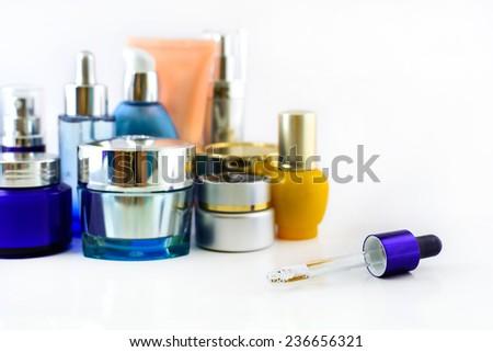 Set of various cosmetics on white background - stock photo