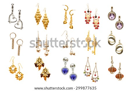 Set of various earrings isolated on white - stock photo