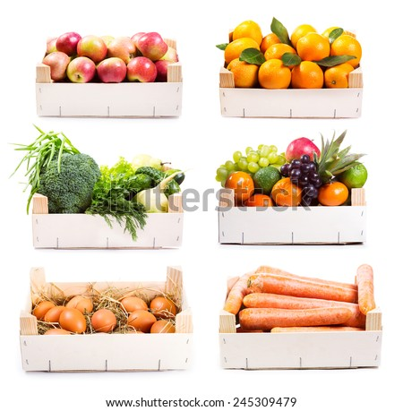 set of various food in wooden box on white background - stock photo