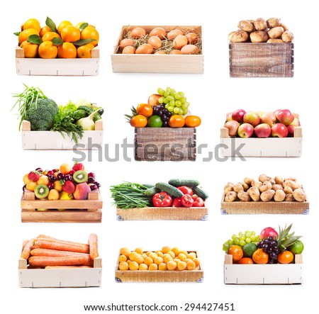 set of various fruits and vegetables in wooden box on white background - stock photo