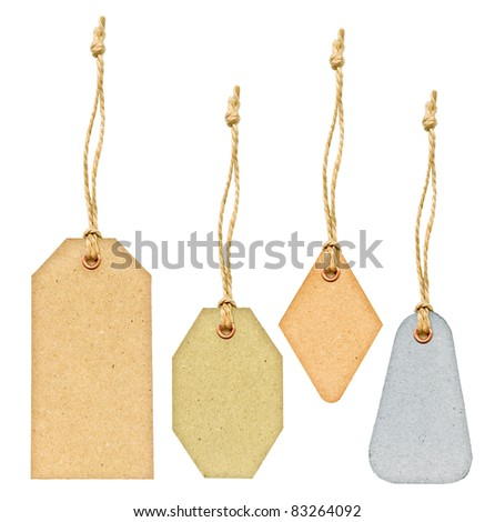 Set of various grungy aged pastel color paper tags with metal rivets and simple traditional strings, isolated on white background