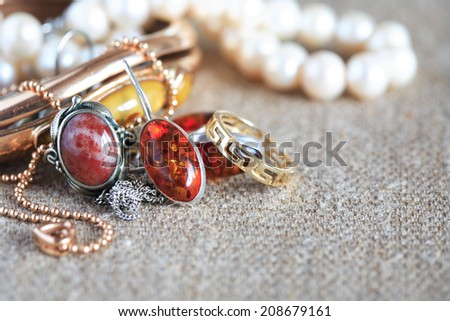 Set of various jewelry on canvas background - stock photo