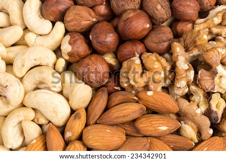 Set of various nuts in bowl as a background - stock photo