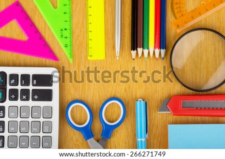 Set of Various office supplies on a wooden table surface - stock photo