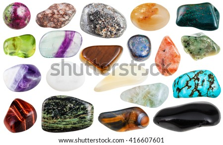set of various polished natural mineral stones and gemstones - sunstone, azurite, chessylite, moonstone, grossular, chrysolite, prasiolite, fluorite, bloodstone, etc isolated on white background - stock photo
