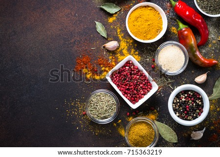 Set of Various spices in a bowls on stone table. Top view with copy space.