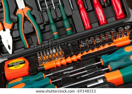 Set of various tools in black box