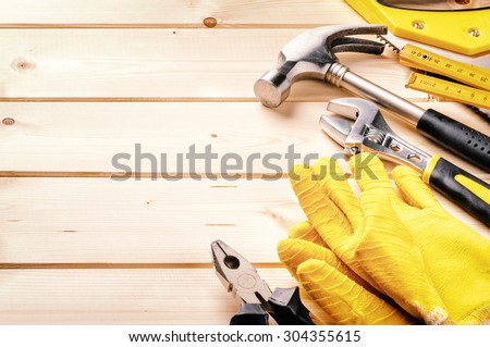 Set of various tools on wooden background. Construction concept - stock photo