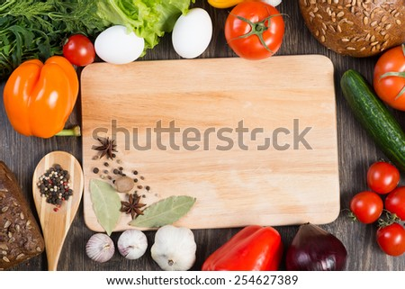 Set of vegetables and spices on kitchen table - stock photo