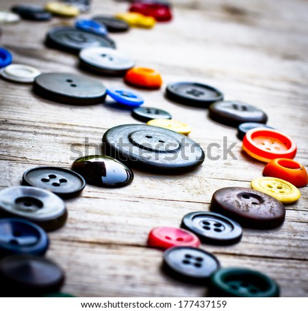 Set of vintage buttons on old wooden table/ Sewing background - stock photo