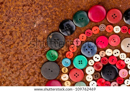 SET OF VINTAGE BUTTONS on the old rusty table - stock photo