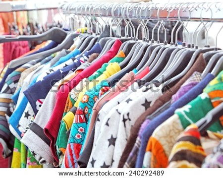 set of vintage clothes of many colors at flea market